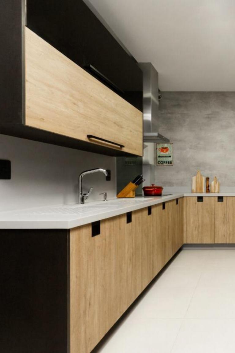 Bancada da cozinha, com material corian. Não poroso, com emendas imperceptíveis e toque suave, é uma opção incrível para o seu projeto!